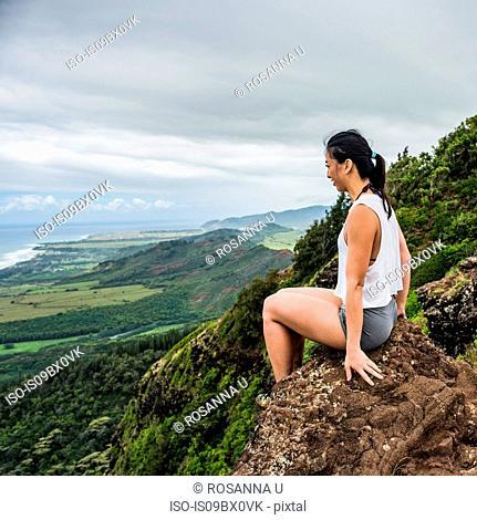 Hiker on rock on top of mountain, Sleeping Giant Trail, Kauai, Hawaii