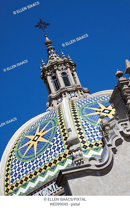 Tiled dome and spire above Museum of Man in Balboa Park San Diego