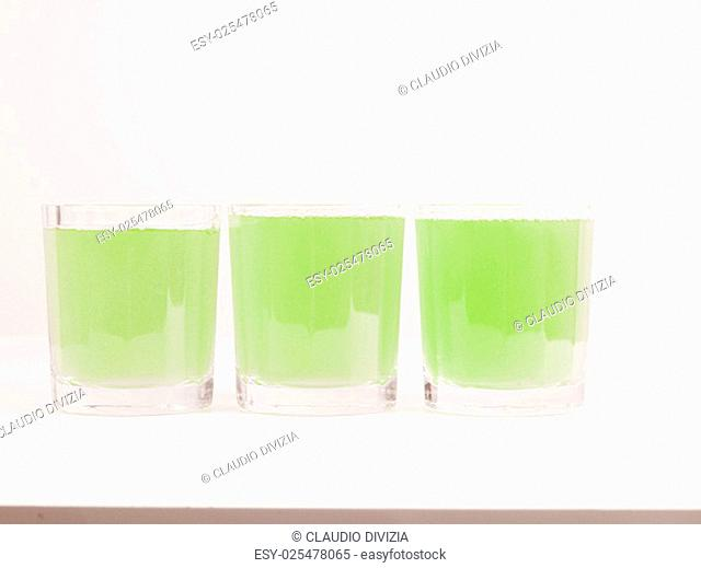 Glasses of green apple juice on continental breakfast table