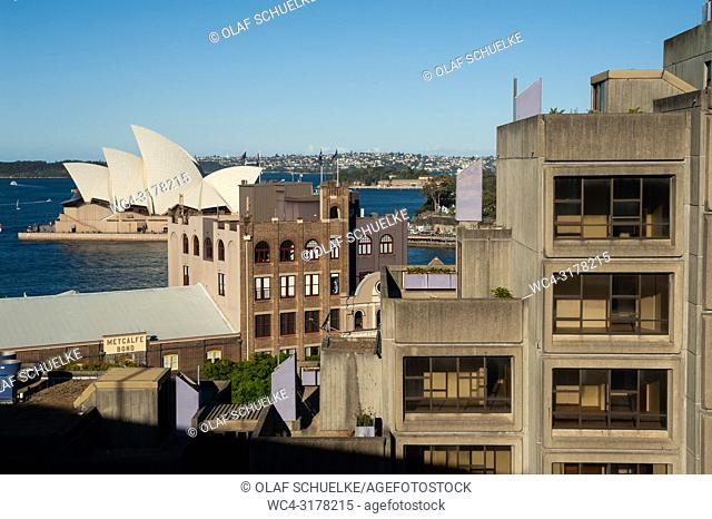 Sydney, New South Wales, Australia - An elevated view from Sydney Harbour Bridge of buildings in the urban locality of The Rocks and the Sydney Opera House on...