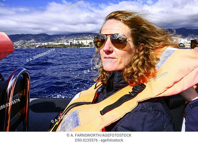 Funchal, Madeira, Portugal, Passengers on a whale and dolphin safari in the Atlantic Ocean on a RIB motorboat