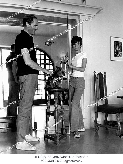 Audrey Hepburn with her husband Mel Ferrer. British actress Audrey Hepburn with her husband Mel Ferrer standing on the set of 'Two for the Road'