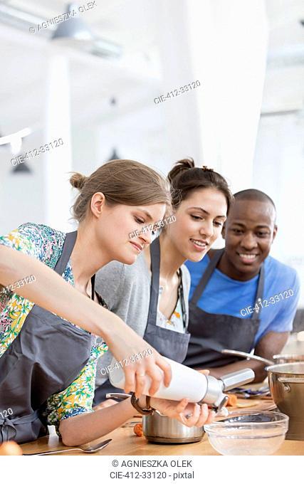 Friends enjoying cooking class in kitchen