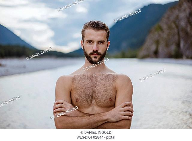 Germany, Bavaria, portrait of shirtless young man in nature