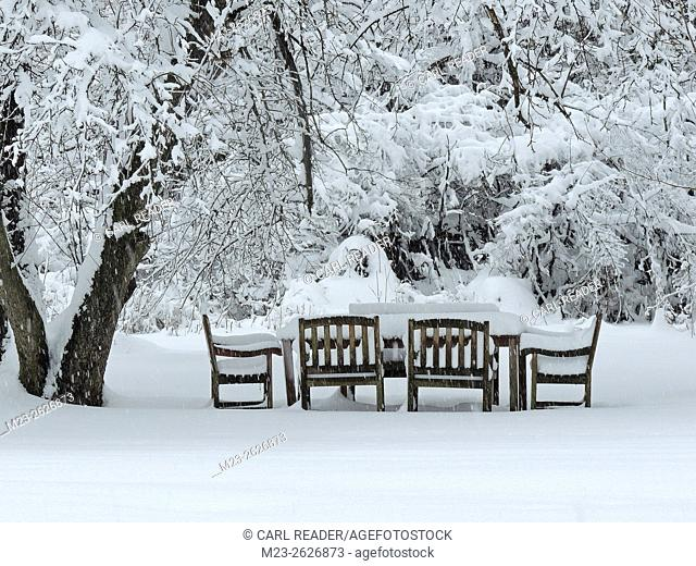 Snow covers an outside table and makes socializing impossible in winter, Pennsylvania, USA