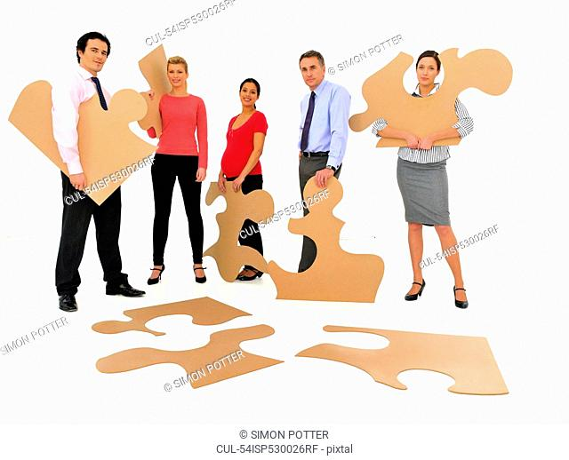 Business people doing jigsaw puzzle