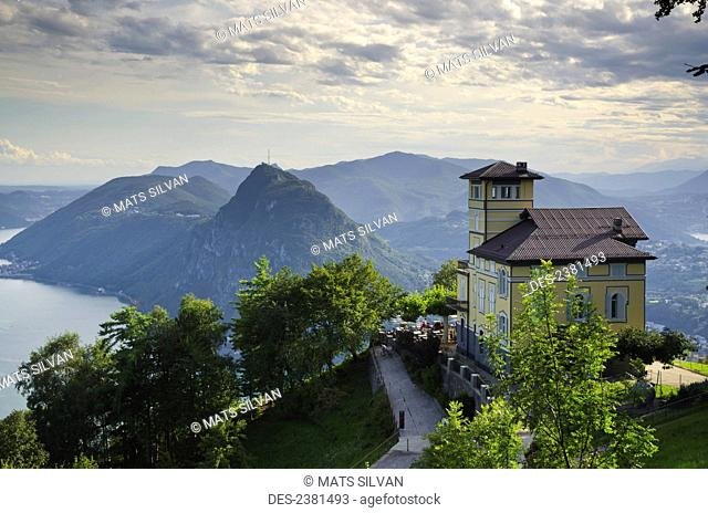 A building at high elevation overlooking the mountains and lakes; Lugano, Ticino, Switzerland