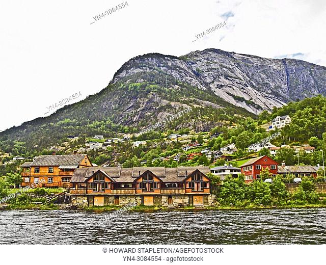 Eio River and hillside houses at Eidfjord, Norway. The Eio river is only 1. 3 miles long and runs from Lake Eidfjord into the Eid Fjord through the village of...
