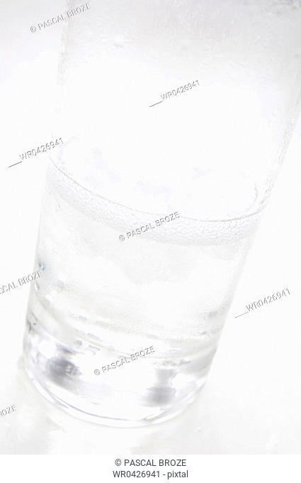 Close-up of ice cubes inside a glass of purified water