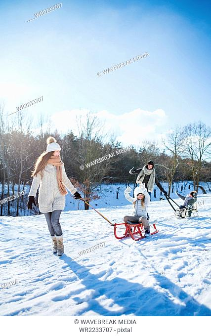 Family playing with sled