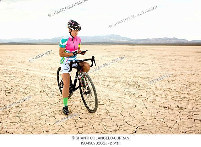 Cyclist stopping in desert, Las Vegas, Nevada, USA