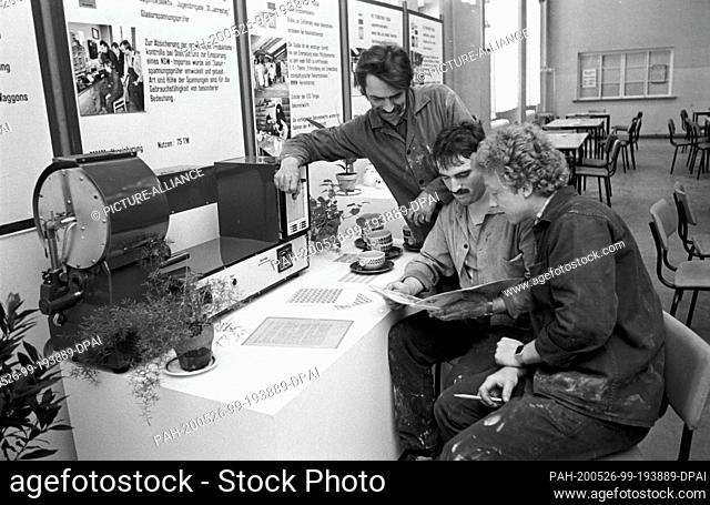 """30 July 1984, Saxony, Torgau: A company exhibition takes place in the mid-1980s at the VEB Steingutwerk Torgau. On the board in the background it says """"""""To..."""