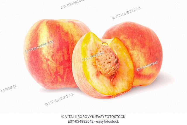 Two whole and half of peach isolated on white background