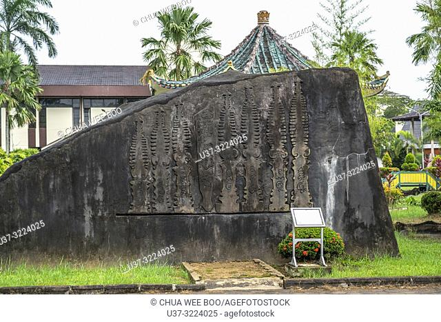 A stone crafted with buddhist symbols displayed at Museum Kalimantan Barat, Pontianak, Indonesia