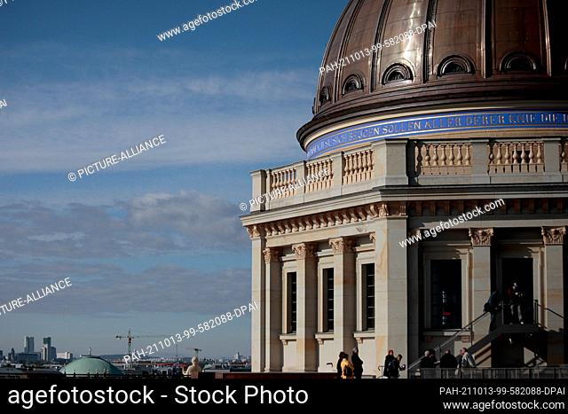 13 October 2021, Berlin: The dome of the Humboldt Forum is reflected in a glass pane on the building's roof terrace. For the first time
