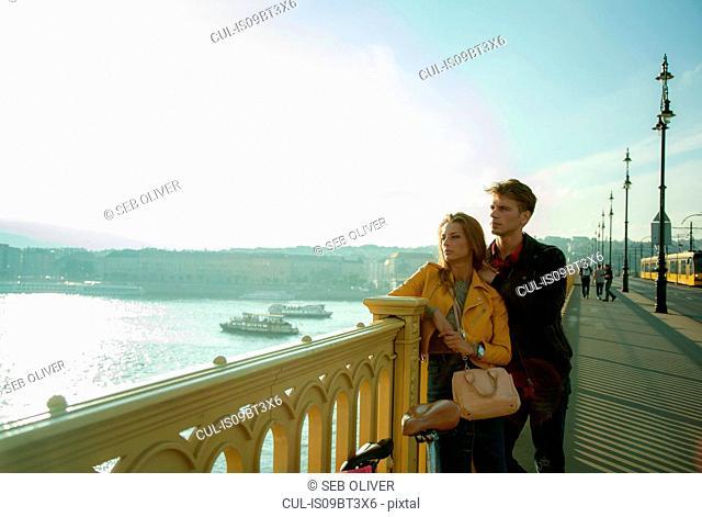 Couple enjoying view from bridge, Budapest, Hungary