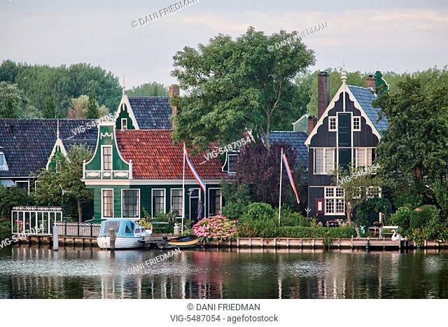Traditional Dutch houses along a canal in the small town of Zaanse Schans, Holland, Netherlands, Europe. - ZAANSE SCHANS, HOLLAND, NETHERLANDS, 15/07/2014