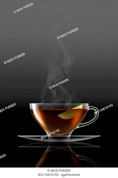 Lemon tea in glass teacup and saucer