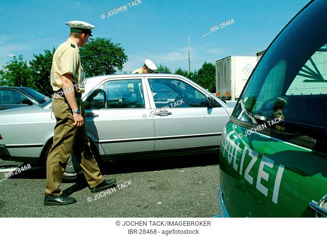 DEU, Germany, NRW: Control of a suspect car on a highway parking area. Highwaypolice, Highway patrol