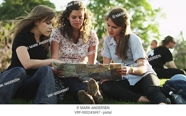 MS Young women studying map / Paris, France