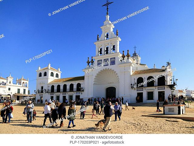 Pilgrims in front of the white Hermitage of El Rocío / Ermita del Rocío, Almonte, Province of Huelva, Andalucia, Spain