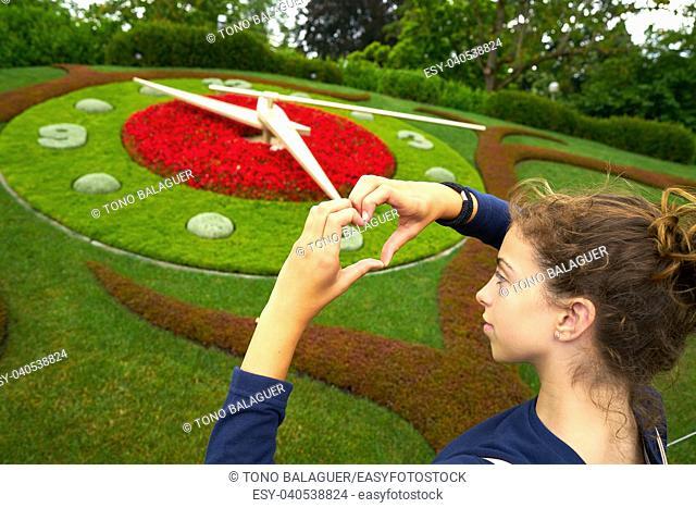Flower clock garden in Geneve tourist girl Geneva Switzerland Swiss