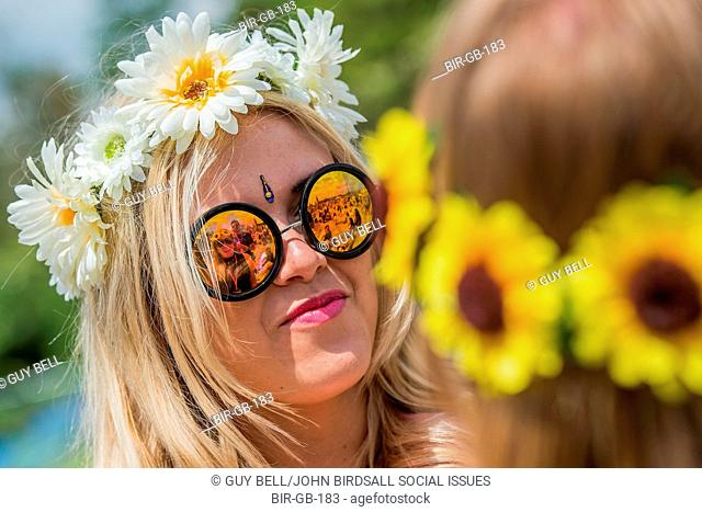 Early arrivals can enjoy the blistering heat in sunglasses and fancy dress. The 2015 Glastonbury Festival, Worthy Farm, Glastonbury