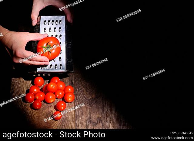 Conceptual A Man Hands Grinds Tomato On A Grater