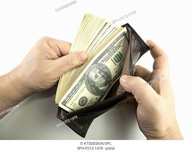 Wallet containing 100 US dollar banknotes