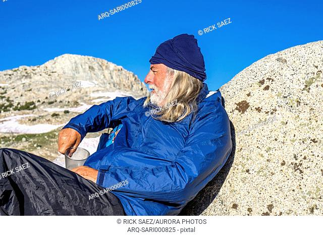 Man enjoying the view at Muriel Lake in Eastern Sierra, Piute Pass, Bishop, California, USA