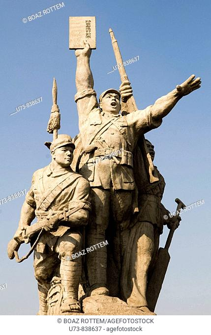 The statue of this communist workers stands on the first bridge over the Yangtze river in Nanjing, Jiangsu, China