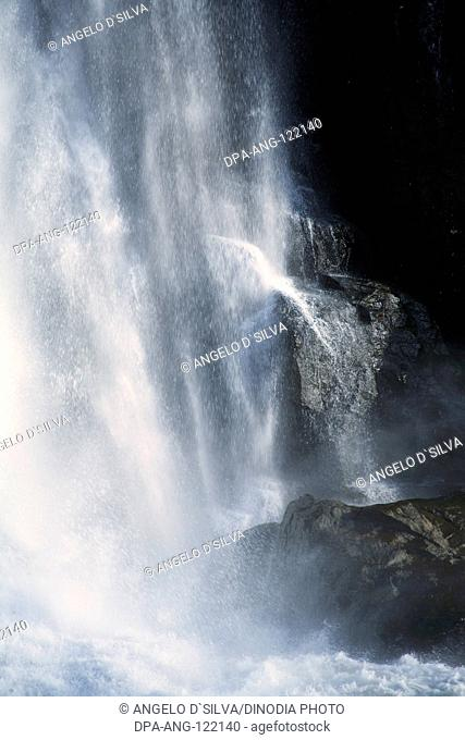 Picnic spot ; landscape Athirappilly waterfall gushing water spray ; District Thrissur ; Kerala ; India