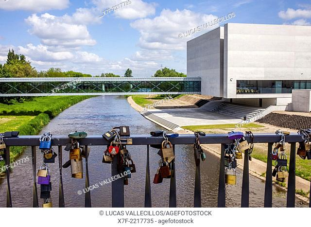 Access bridge to the Ostrow Tumski island, in background the ICHOT Brama Poznania, Poznan, Poland