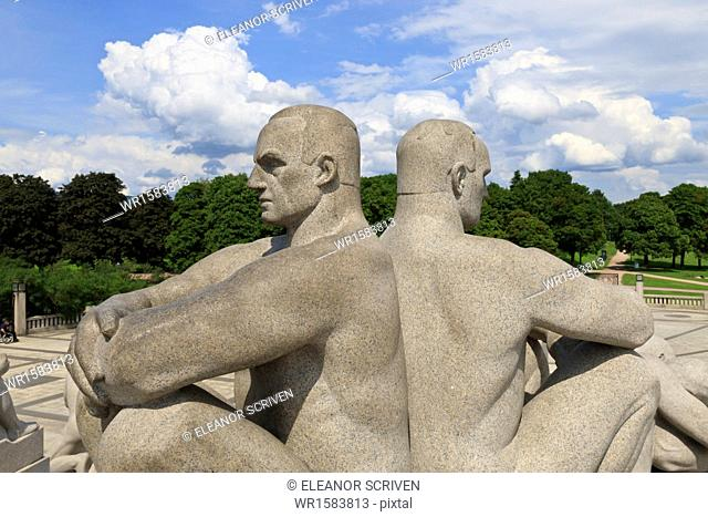 Back to back, detail of a sculptural group on the Monolith Plateau by Gustav Vigeland, Frogner Park, Oslo, Norway, Scandinavia, Europe