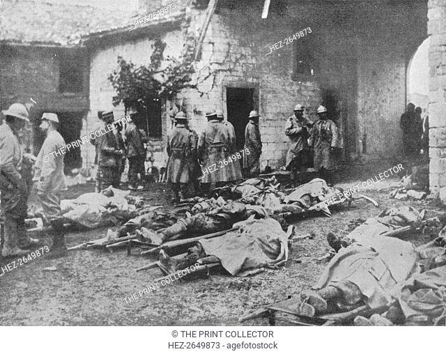 'French wounded being removed during an attack to a farm in the rear of the lines', 1915. Artist: Unknown