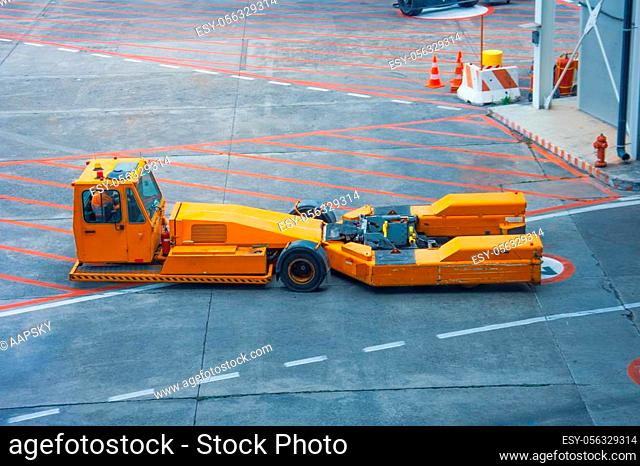Towing vehicles in the airport waiting for the plane to be repaired