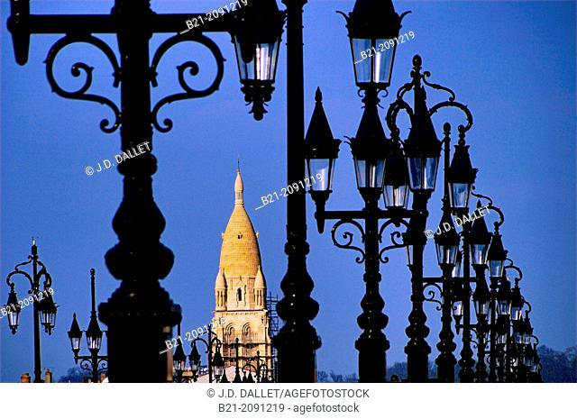 Tower of Sainte Marie de la Bastide church and lamps of the Pont de Pierre (Stone Bridge), Bordeaux, Gironde, Aquitaine, France