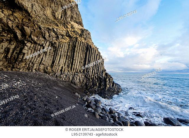 Basaltic lava flow solidified forming columns in the beaches of Vik, Iceland