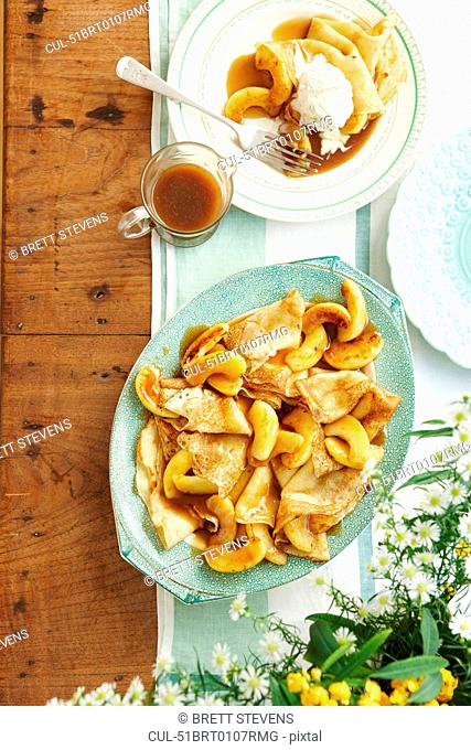 Plate of toffee apple pancakes and sauce