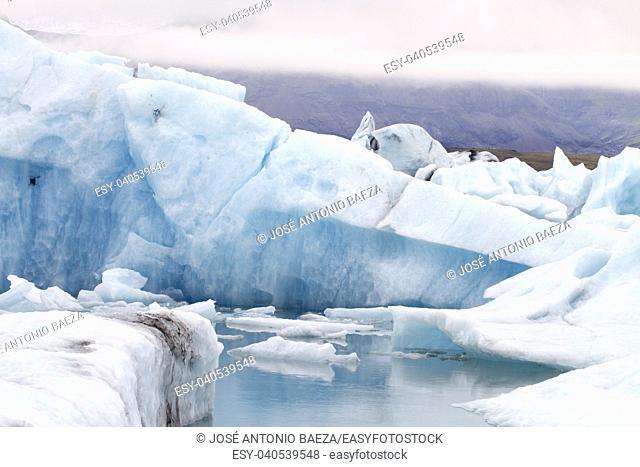 blue iceberg in the Vatnajökull glacier. . .