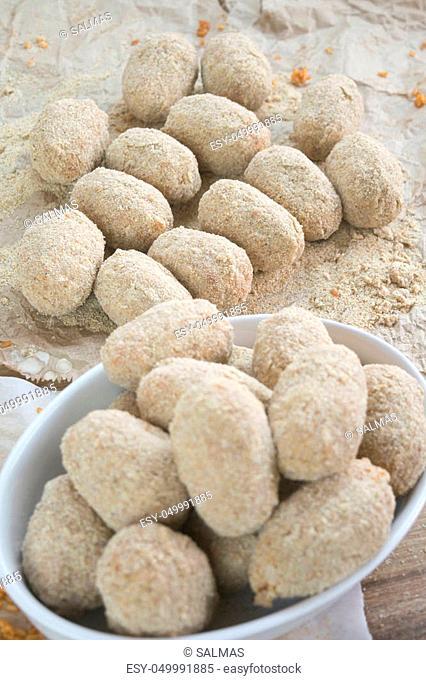 doing handmade potato croquettes with filling of mozzarella