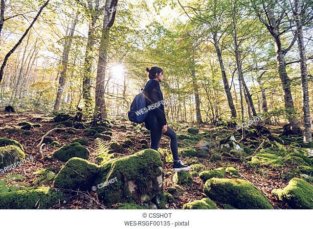 Spain, Navarra, Irati Forest, young woman standing in lush forest