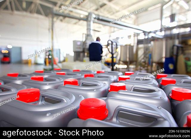 Plastic containers with lids on the background of chemical production