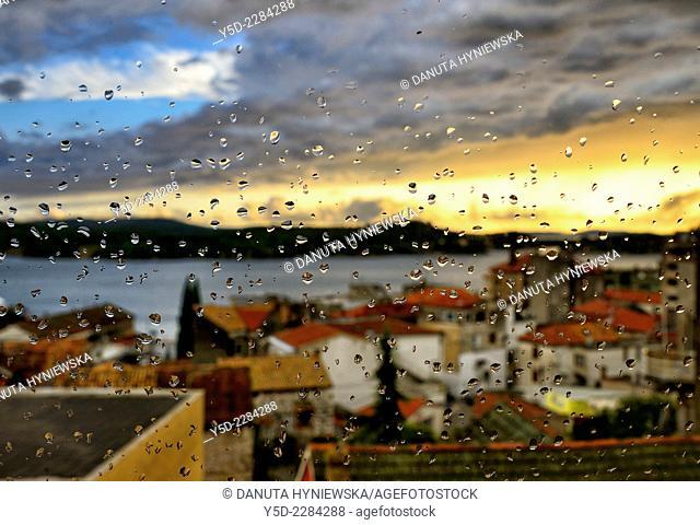 Old town of Sibenik seen through the window in heavy rain, Dalmatia, Croatia, Europe