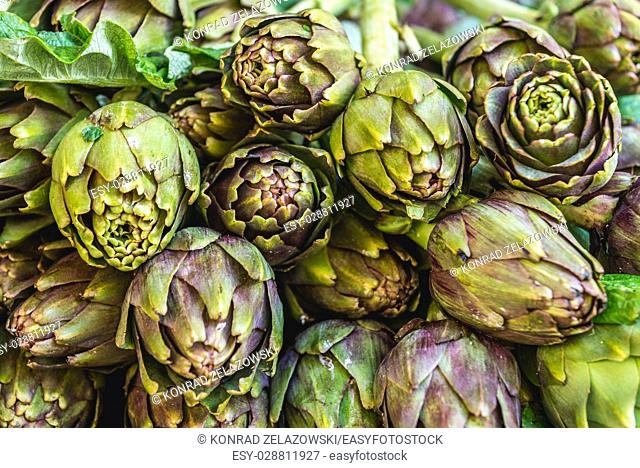 Artichokes for sale on a daily outdoor market in Syracuse city, southeast corner of the island of Sicily, Italy