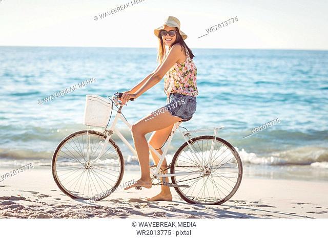 Pretty brunette woman on a bike ride