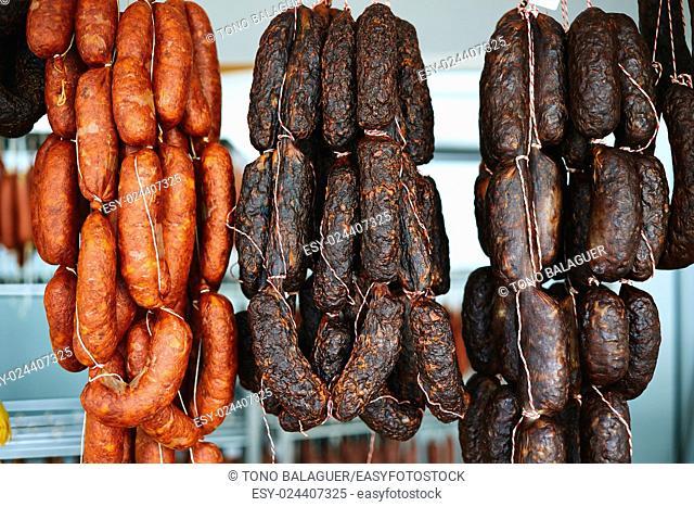 Mediterranean sausages in spain hanging in rows