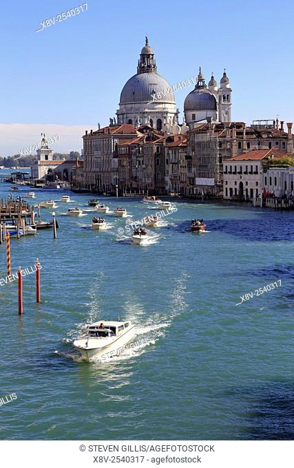Water taxis on the Grand Canal and Santa Maria della Salute Dorsoduro from the Accademia Bridge, Venice, Italy