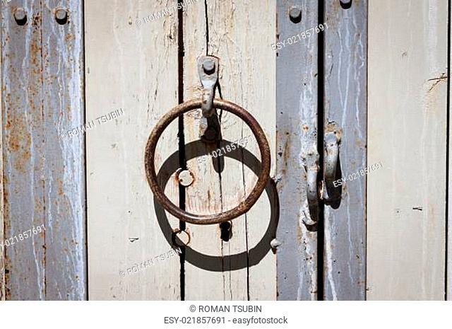 Decorative knob handle on wooden door