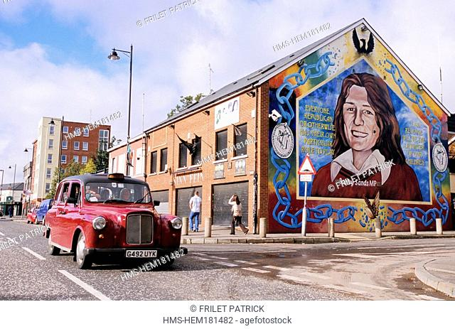 United Kingdom, Northern Ireland Ulster, Belfast, Falls Catholic Republican District, mural and cab in the street